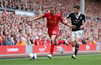 Hi-res-181443035-lucas-of-liverpool-in-action-with-adam-lallana-of_display_image