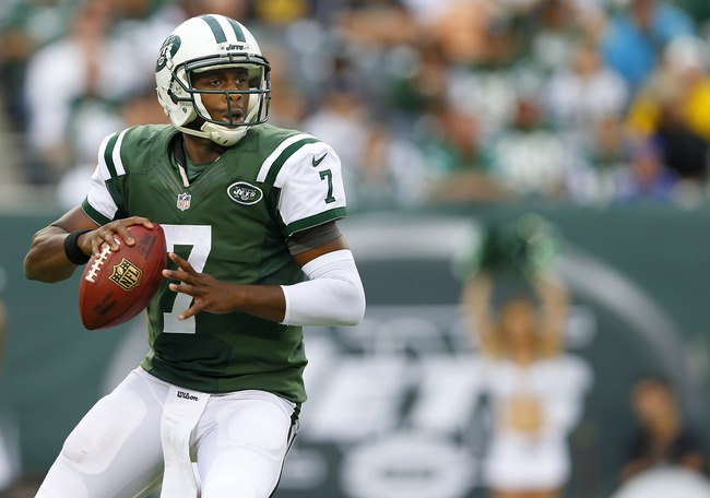 Hi-res-181764388-quarterback-geno-smith-of-the-new-york-jets-looks-to_crop_650