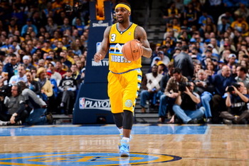 167522019-ty-lawson-of-the-denver-nuggets-advances-the-ball_display_image