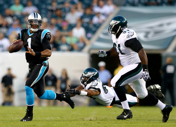 Hi-res-176579875-cam-newton-of-the-carolina-panthers-scrambles-as-mychal_display_image