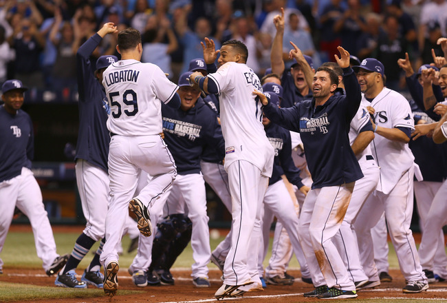 Hi-res-183603461-jose-lobaton-of-the-tampa-bay-rays-is-greeted-at-home_crop_650x440