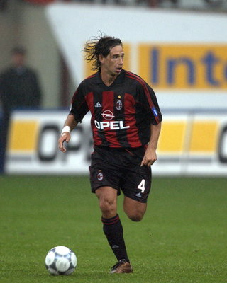 Hi-res-1054847-sep-2001-demetrio-albertini-of-ac-milan-in-action-during_display_image