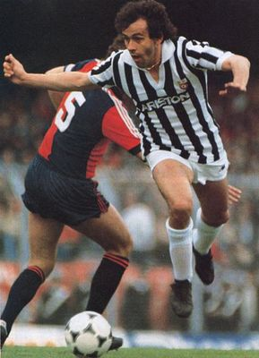 Michel Platini battles against Genoa for Juventus.