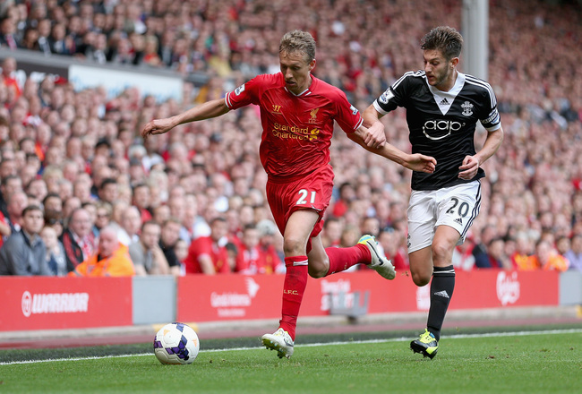 Hi-res-181443035-lucas-of-liverpool-in-action-with-adam-lallana-of_crop_650x440