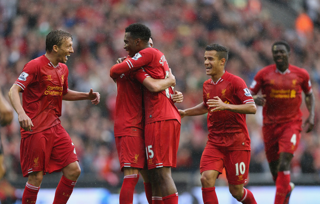 Hi-res-176694608-daniel-sturridge-of-liverpool-is-congratulated-by-iago_crop_650