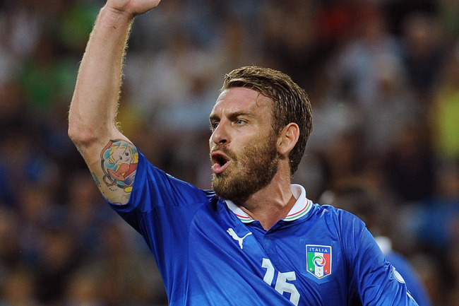 Hi-res-180305851-daniele-de-rossi-of-italy-reacts-during-the-fifa-2014_crop_650