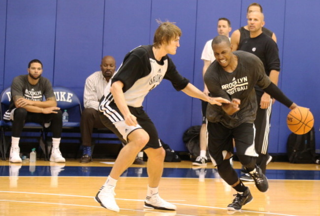 183101230-paul-pierce-and-andrei-kirilenko-of-the-brooklyn-nets_crop_650x440
