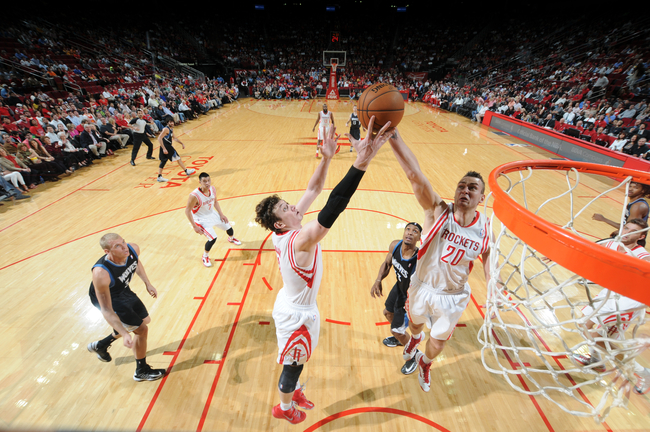 Hi-res-163780649-donatas-motiejunas-and-omer-asik-of-the-houston-rockets_crop_650