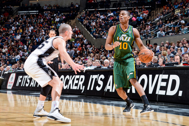 Hi-res-164360375-alec-burks-of-the-utah-jazz-controls-the-ball-against_crop_650