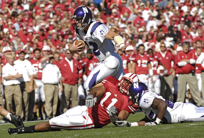 Hi-res-121571150-wildcat-quarterback-andrew-brewer-makes-his-way-around_crop_650x440