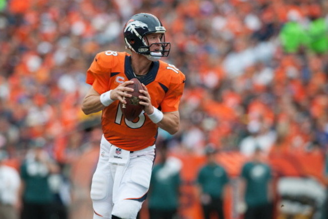 182607819-quarterback-peyton-manning-of-the-denver-broncos-rolls_crop_650