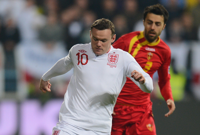 Hi-res-164692257-wayne-rooney-runs-with-the-ball-during-the-fifa-2014_crop_650x440