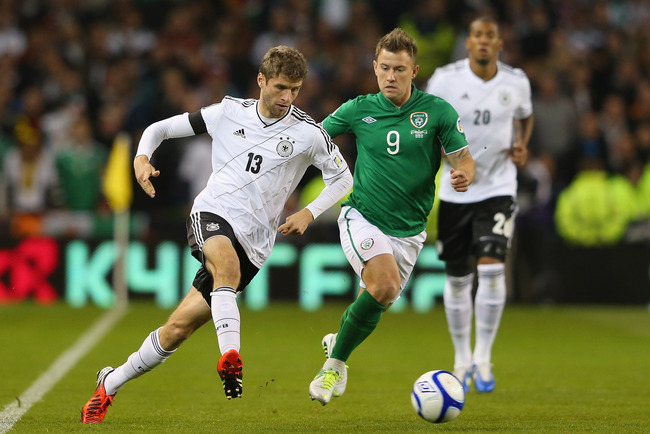 Hi-res-154146103-thomas-muller-of-germany-beats-simon-cox-of-republic-of_crop_650