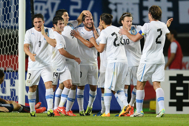 Hi-res-176623538-alvaro-gonzalez-of-uruguay-celebrates-with-team-mates_crop_650