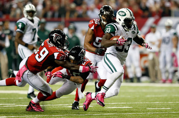 Hi-res-183605588-running-back-chris-ivory-of-the-new-york-jets-breaks-a_display_image