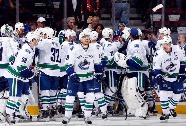 Hi-res-183484668-the-vancouver-canucks-celebrate-a-5-4-overtime-win_crop_650x440
