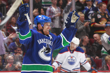 Hi-res-183207690-daniel-sedin-celebrates-after-scoring-against-the_display_image