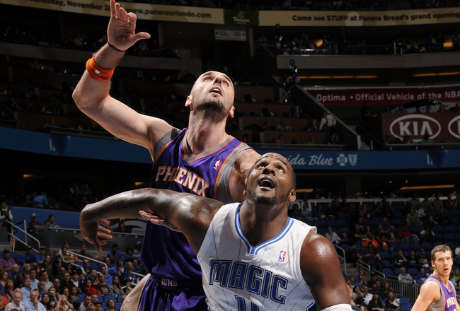 Hi-res-155485659-glen-davis-of-the-orlando-magic-boxes-out-marcin-gortat_crop_650x440