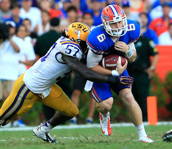 Hi-res-154740265-lamin-barrow-of-the-lsu-tigers-tackles-jeff-driskel-of_crop_650