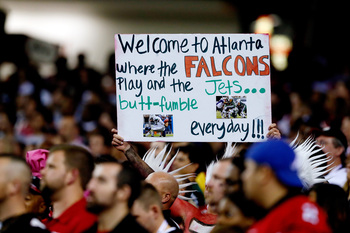 Hi-res-183603418-fan-holds-up-a-sign-during-a-game-between-the-atlanta_display_image