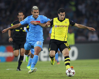 Hi-res-180967957-henrikh-mkhitaryan-of-borussia-dortmund-competes-for_display_image