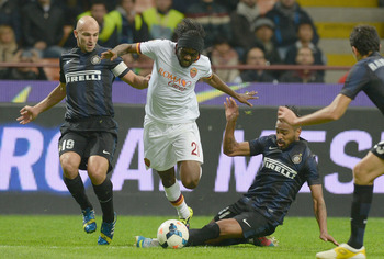 Hi-res-183178916-alvaro-pereira-of-fc-inter-milan-and-gervinho-of-as_display_image