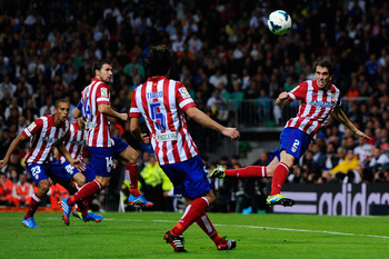 Hi-res-182580803-diego-godin-of-atletico-de-madrid-clear-the-ball-during_display_image