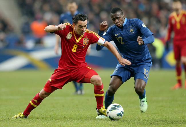 Hi-res-164723619-xavi-of-spain-in-action-with-blaise-matuidi-of-france_crop_650