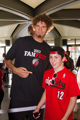 Hi-res-183592819-robin-lopez-of-the-portland-trail-blazers-greets-fans_display_image