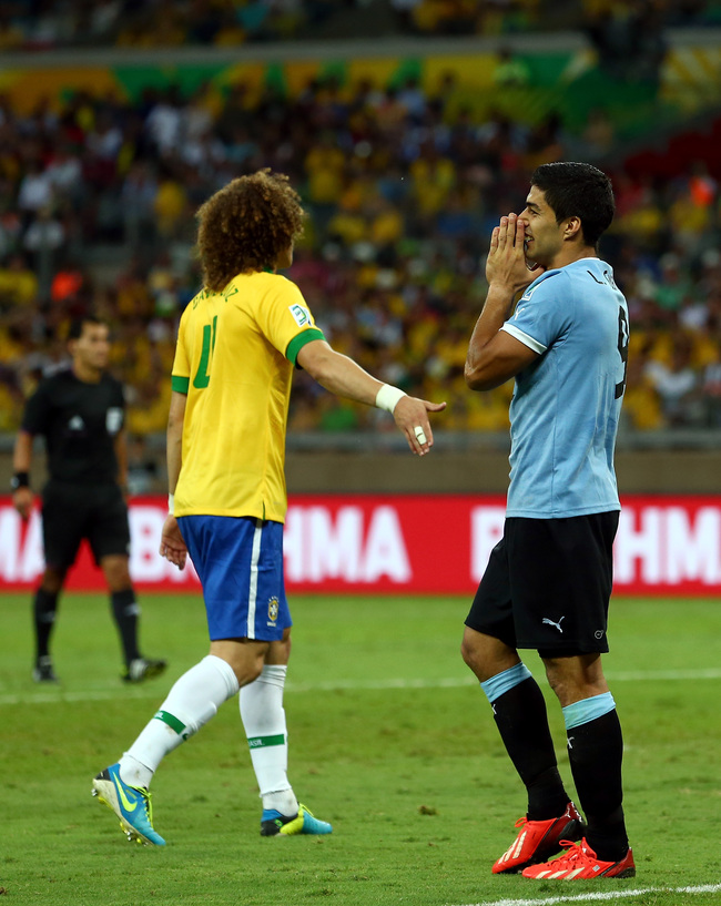 Hi-res-171563899-david-luiz-of-brazil-consoles-luis-suarez-of-uruguay_crop_650