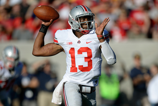 Hi-res-180586578-kenny-guiton-of-the-ohio-state-buckeyes-rolls-out-to_crop_650