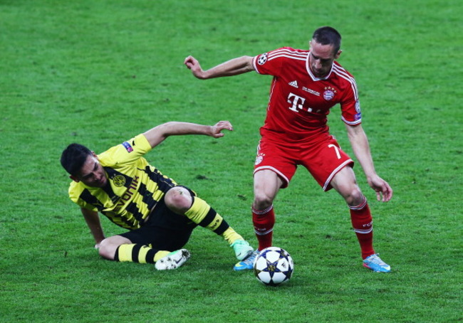 169506411-ilkay-gundogan-of-borussia-dortmund-tackles-franck_crop_650