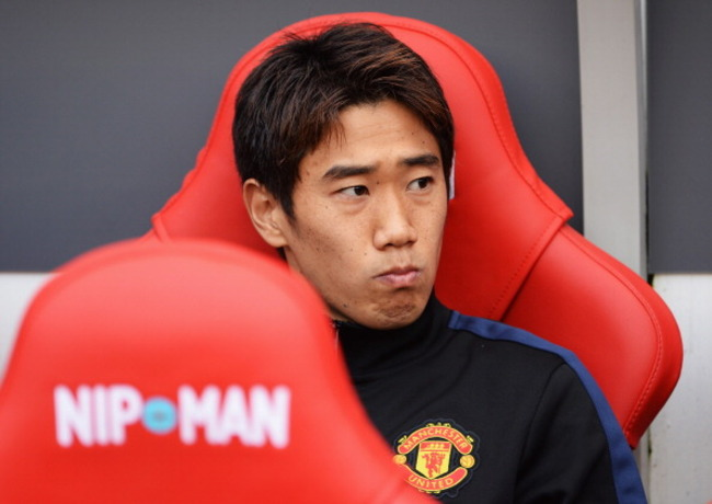 183158973-shinji-kagawa-of-manchester-united-looks-on-from-the_crop_650