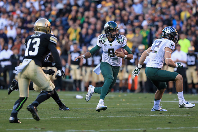 Hi-res-183208364-quarterback-marcus-mariota-of-the-oregon-ducks_crop_650
