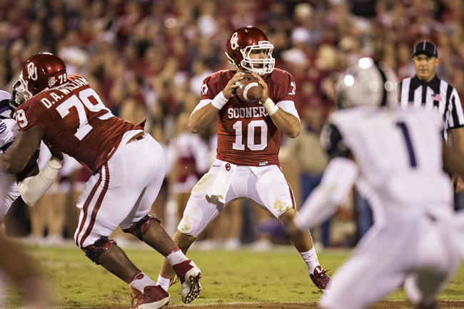Hi-res-183200673-blake-bell-of-the-oklahoma-sooners-drops-back-to-pass_crop_650