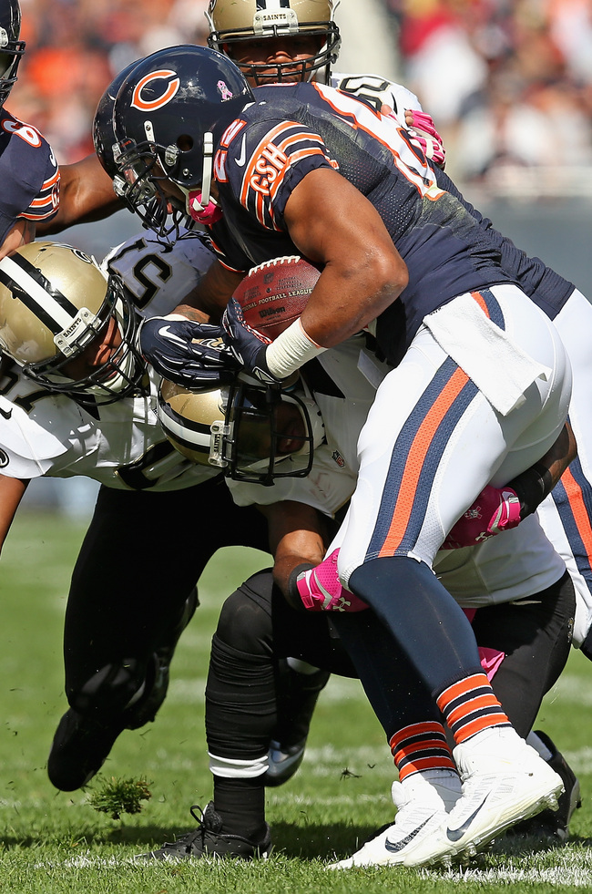Hi-res-183472020-matt-forte-of-the-chicago-bears-is-tackled-by-rafael_crop_650