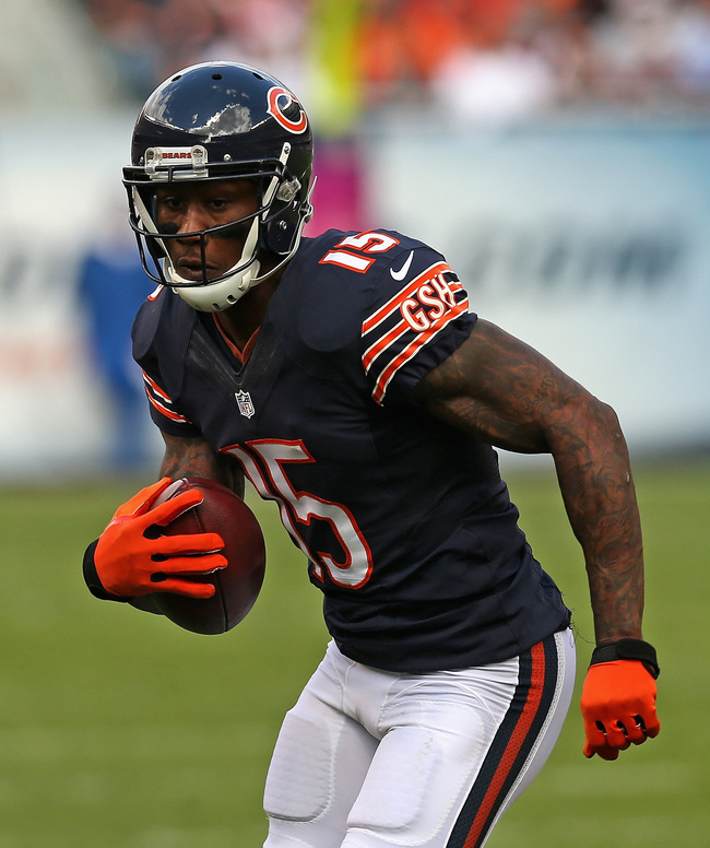 Hi-res-183567752-brandon-marshall-of-the-chicago-bears-runs-after-a_crop_650