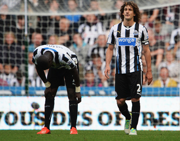 Hi-res-181439873-moussa-sissoko-of-newcastle-united-and-team-mate_display_image