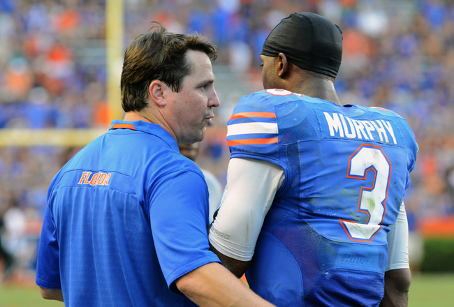 Hi-res-181484005-coach-will-muschamp-talks-with-quarterback-tyler-murphy_crop_650x440