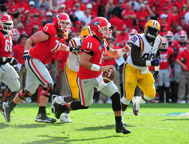Hi-res-182258590-aaron-murray-of-the-georgia-bulldogs-scrambles-against_crop_650