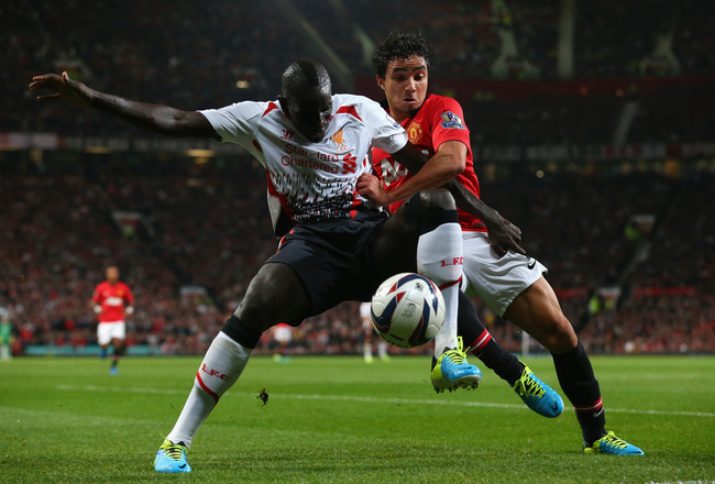 Hi-res-181800340-rafael-of-manchester-united-competes-with-mamadou-sakho_crop_650x440