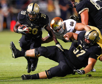 Hi-res-180588915-dalyn-dawkins-of-the-purdue-boilermakers-runs-the-ball_display_image