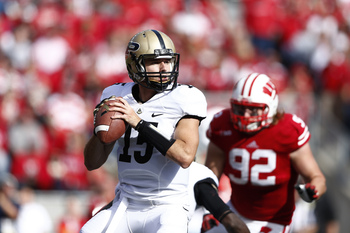 Hi-res-181474793-rob-henry-of-the-purdue-boilermakers-looks-to-pass-the_display_image