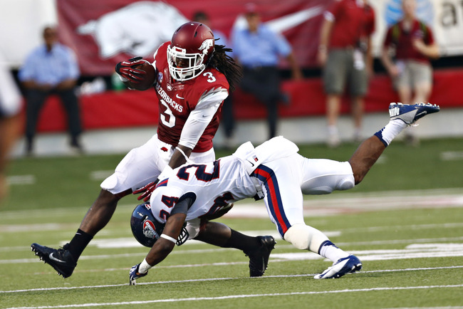 Hi-res-179984651-alex-collins-of-the-arkansas-razorbacks-is-tackled-by_crop_650