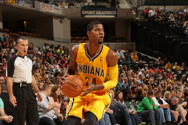 Hi-res-183192520-paul-george-of-the-indiana-pacers-drives-against-the_crop_650