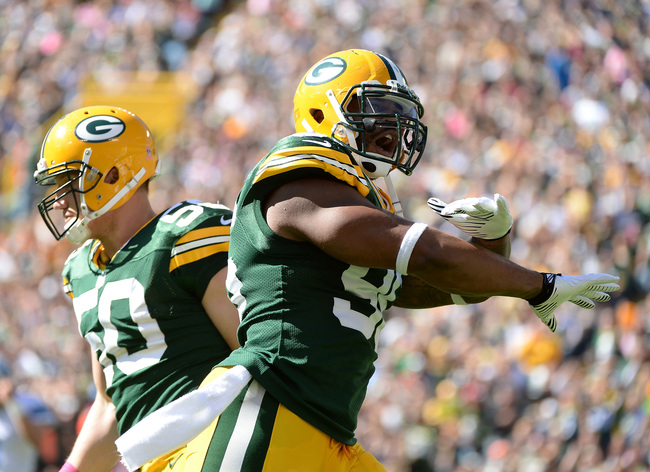 Hi-res-183674229-mike-neal-of-the-green-bay-packers-reacts-with-a-j-hawk_crop_650