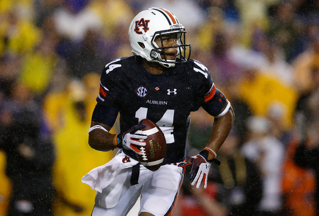 Hi-res-181493331-nick-marshall-of-the-auburn-tigers-looks-to-throw-a_crop_650x440