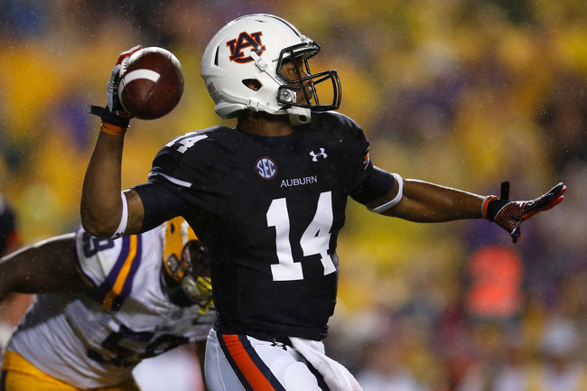 Hi-res-181493328-nick-marshall-of-the-auburn-tigers-looks-to-throw-a_crop_650
