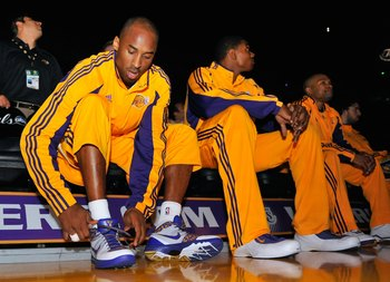 Hi-res-88263605-kobe-bryant-of-the-los-angeles-lakers-ties-his-shoes_display_image