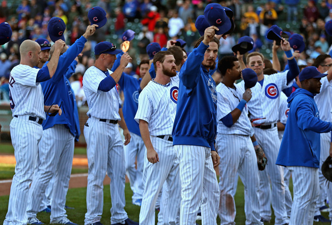 Hi-res-181809505-members-of-the-chicago-cubs-tip-their-hats-to-the-crowd_crop_650x440